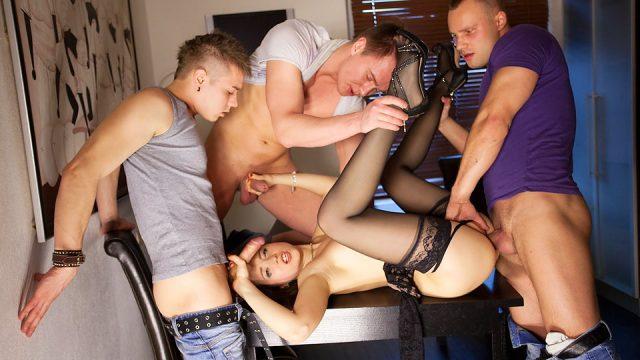 Slut in black stockings fuck three guys at once